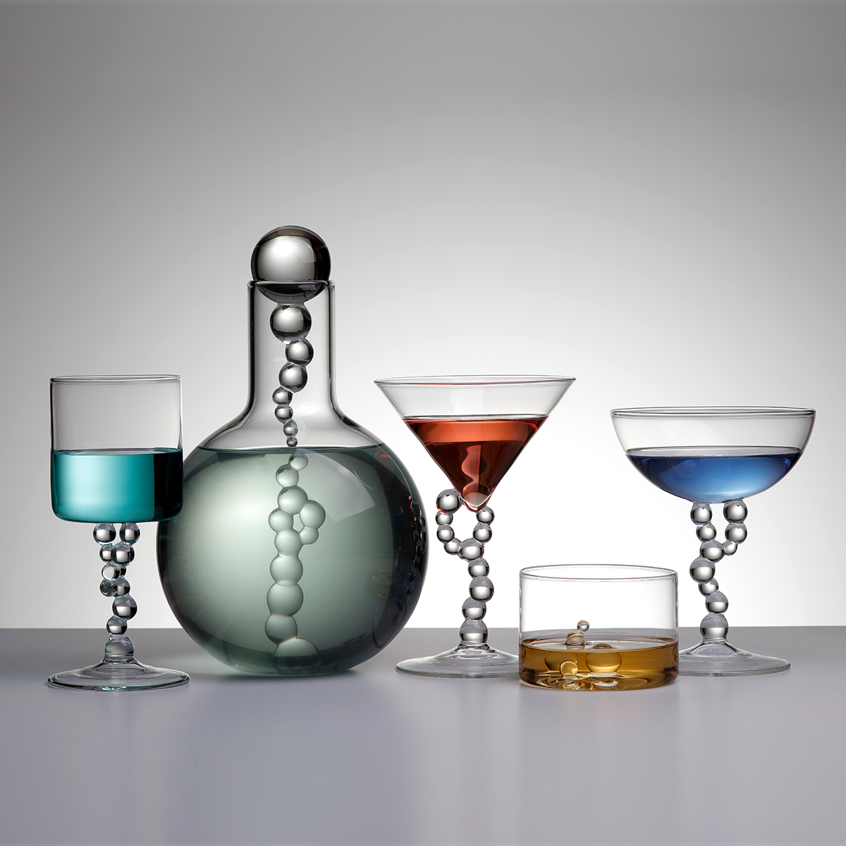 Hand-blown glasses and glass bottle
