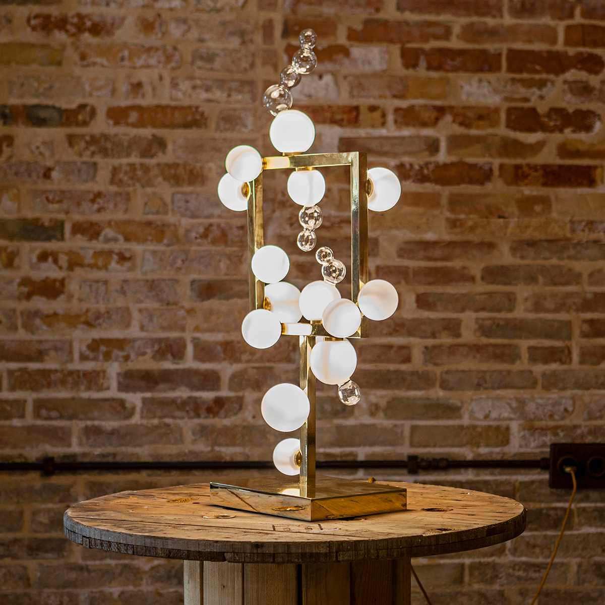 Handmade glass and brass table lamp design