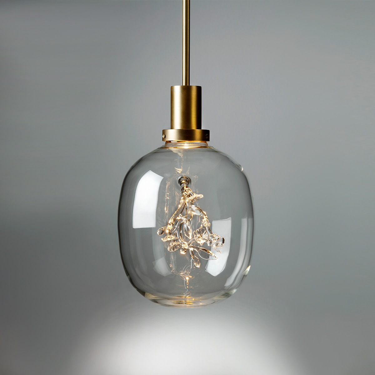 Hand-blown glass and brass light design